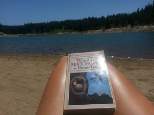 On the beach with To Kill a Mockingbird