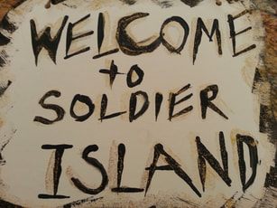 Welcome to Soldier Island sign for Halloween book club