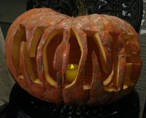 Pumpkin carved with NONE from book title
